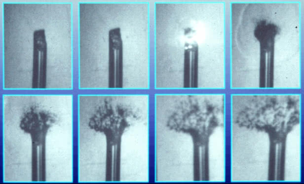 Photo series of the explosion of a damaged glass fiber tip triggered by a high-intensity laser pulse